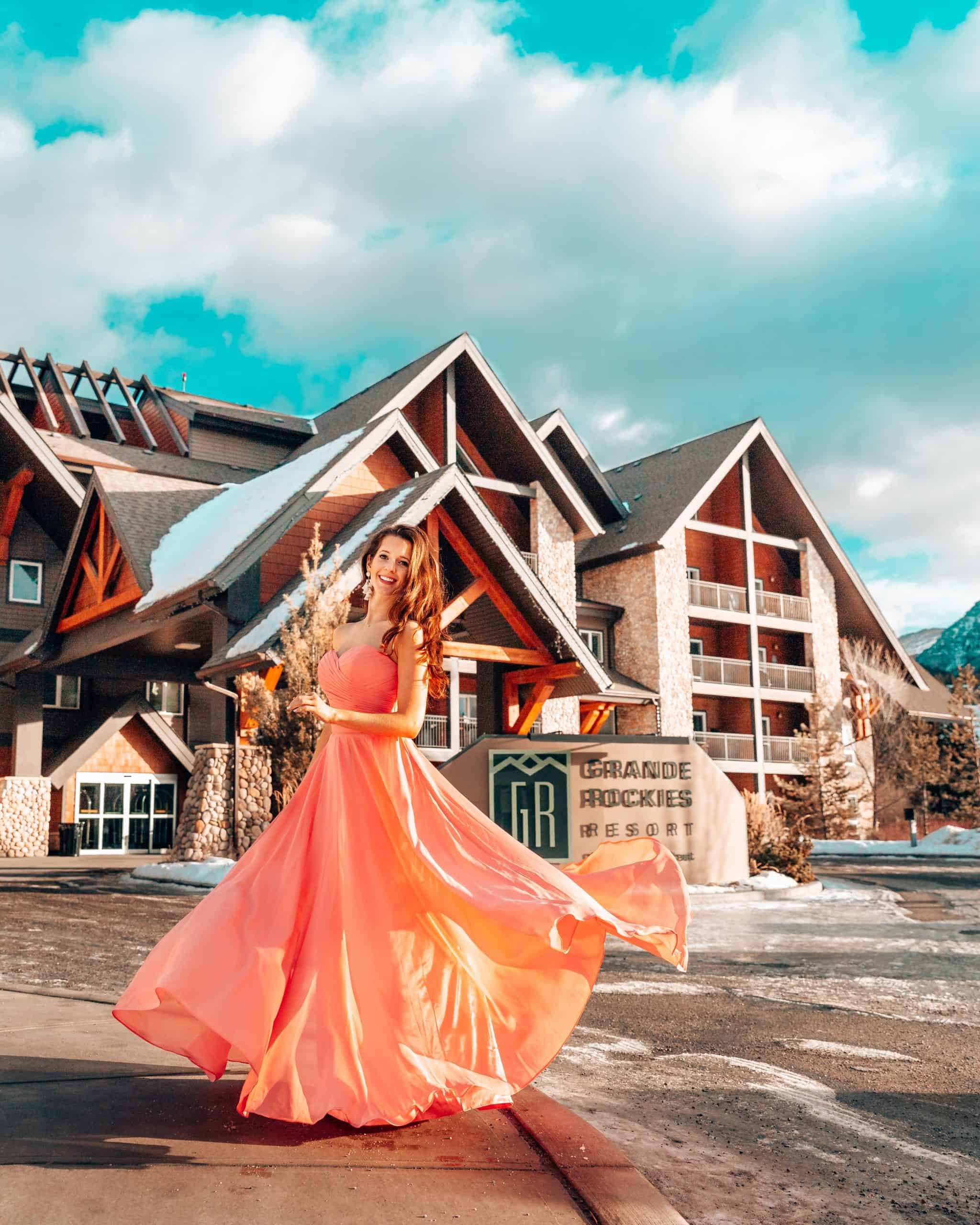Girl twirling at Grande Rockies Resort Canmore - The Next Trip