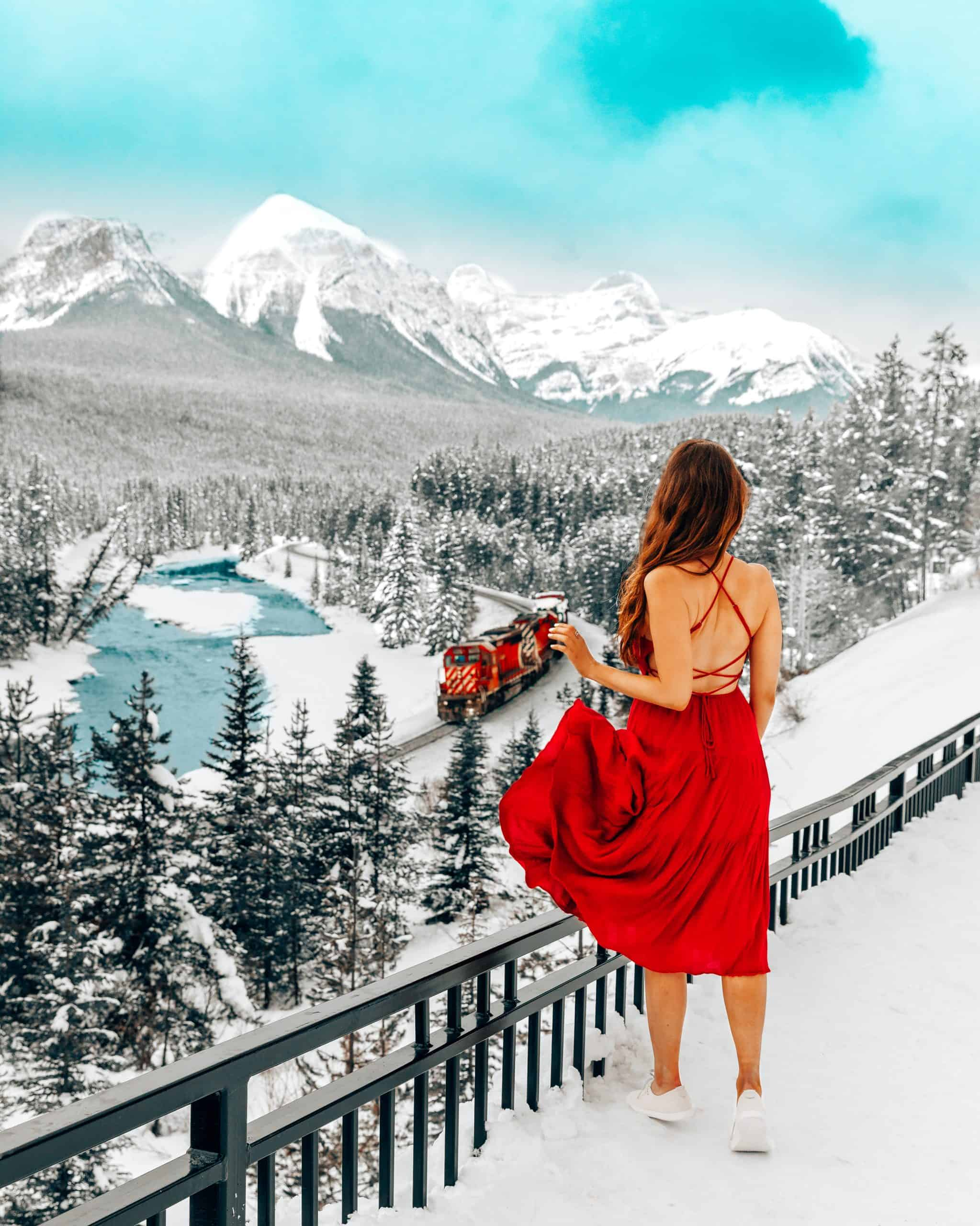 Girl in Red Dress at Morant's Curve in Banff - The Next Trip