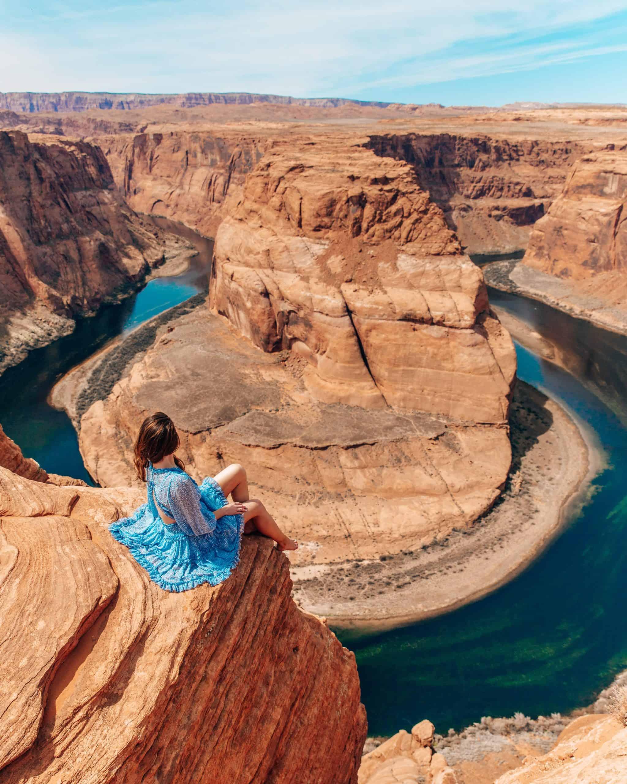 Girl Sitting and Overlooking Horseshoe Bend Arizona