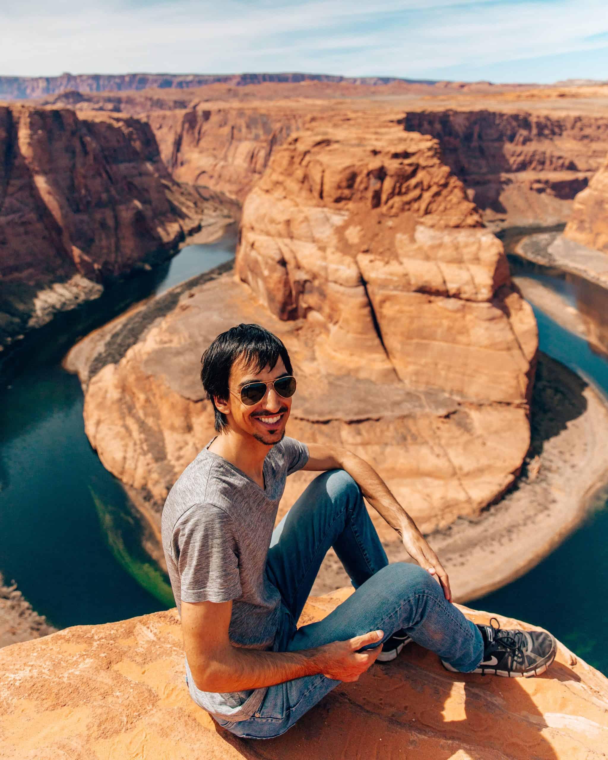 Guy Sitting on Rock at Horseshoe Bend Arizona