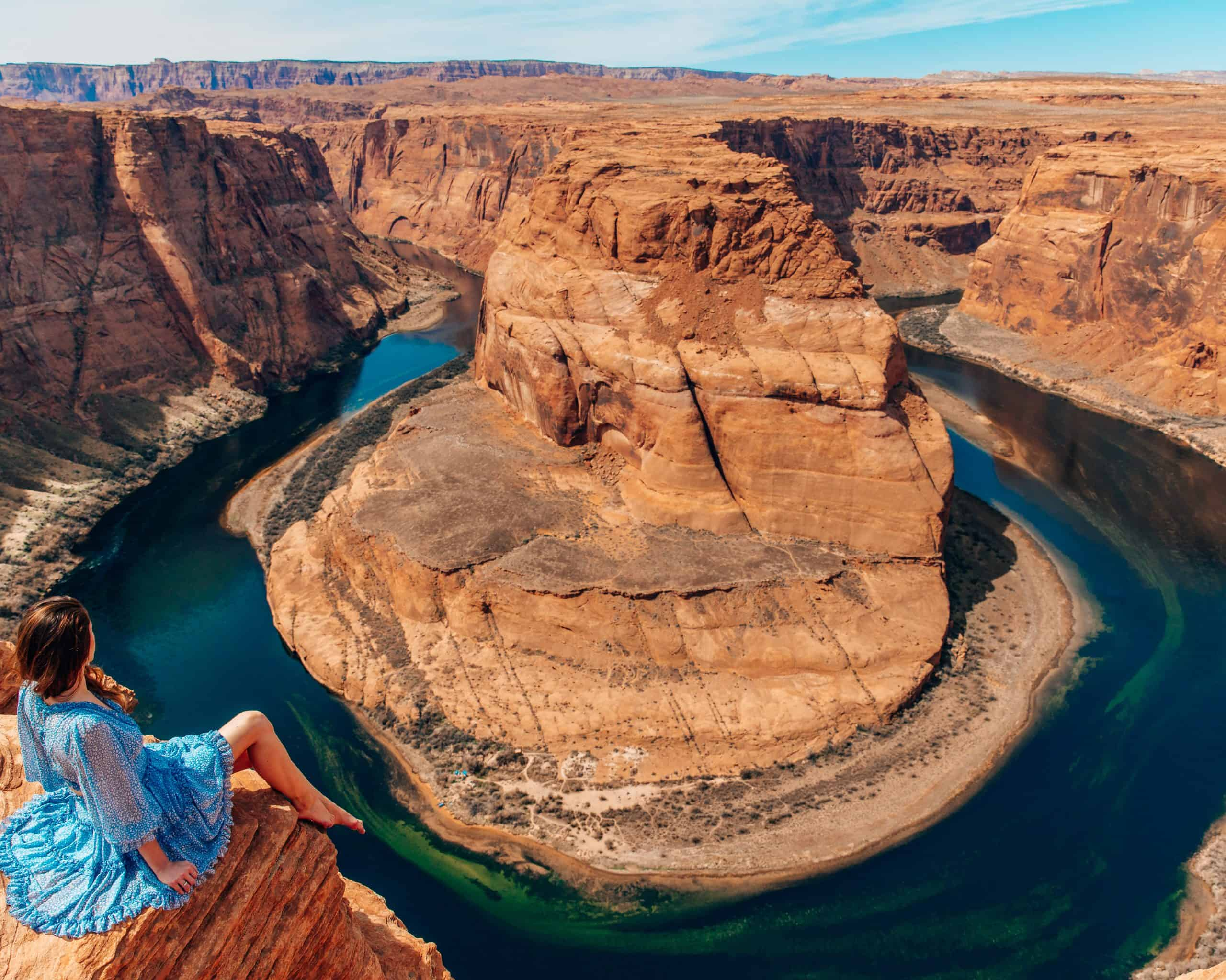 Girl Sitting on Top of Horseshoe Bend