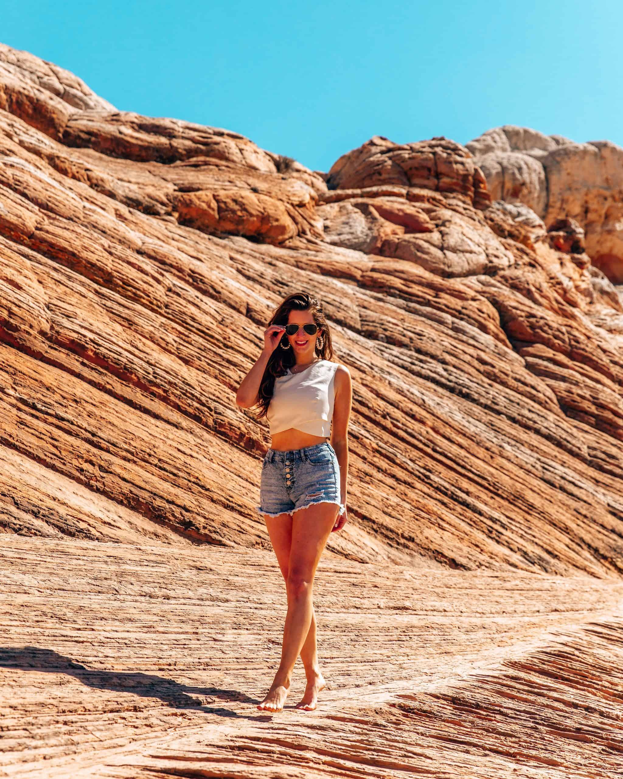 Girl walking on rock formation at White Pocket Arizona