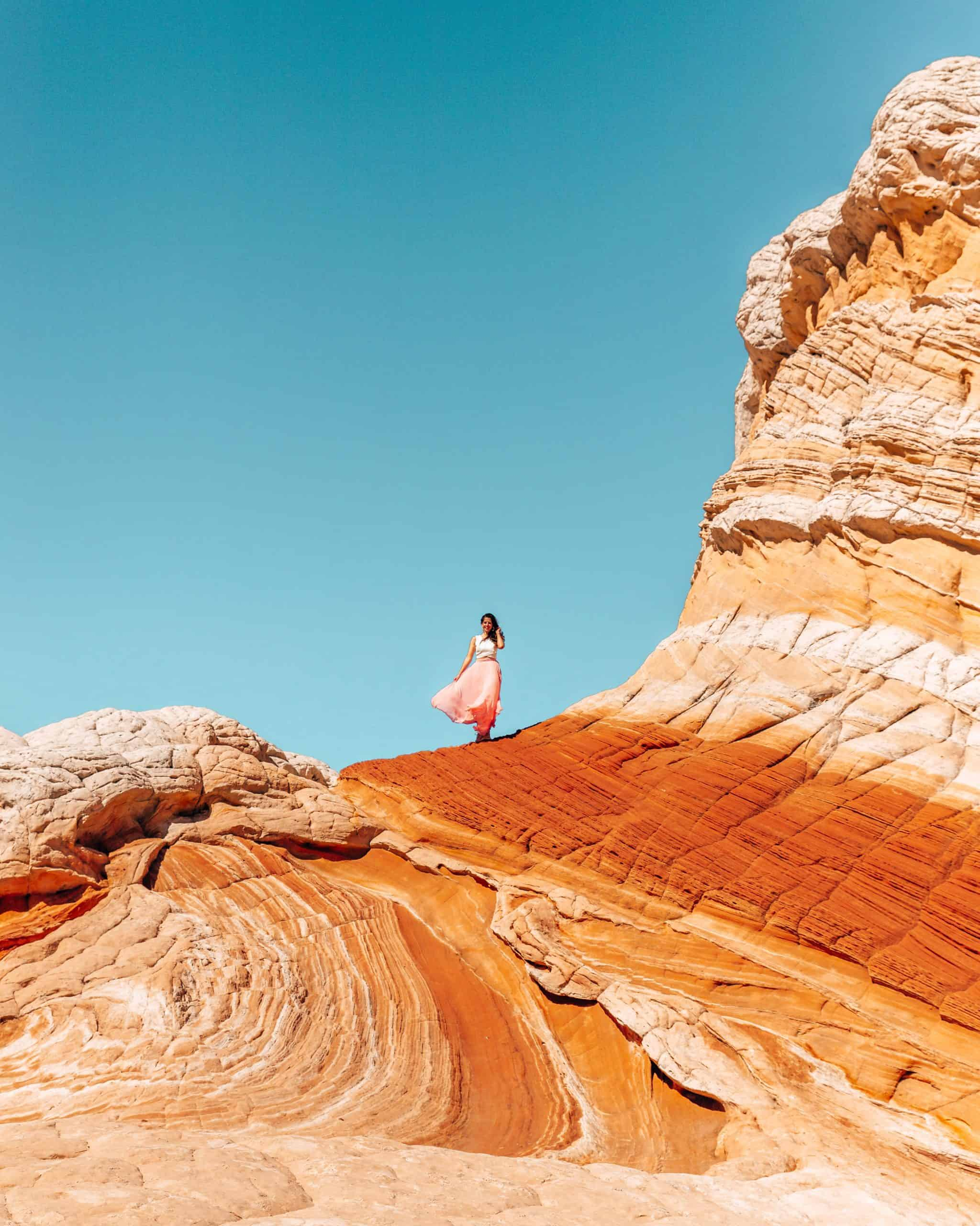 Girl Standing on Rock Formation Wave in White Pocket Arizona