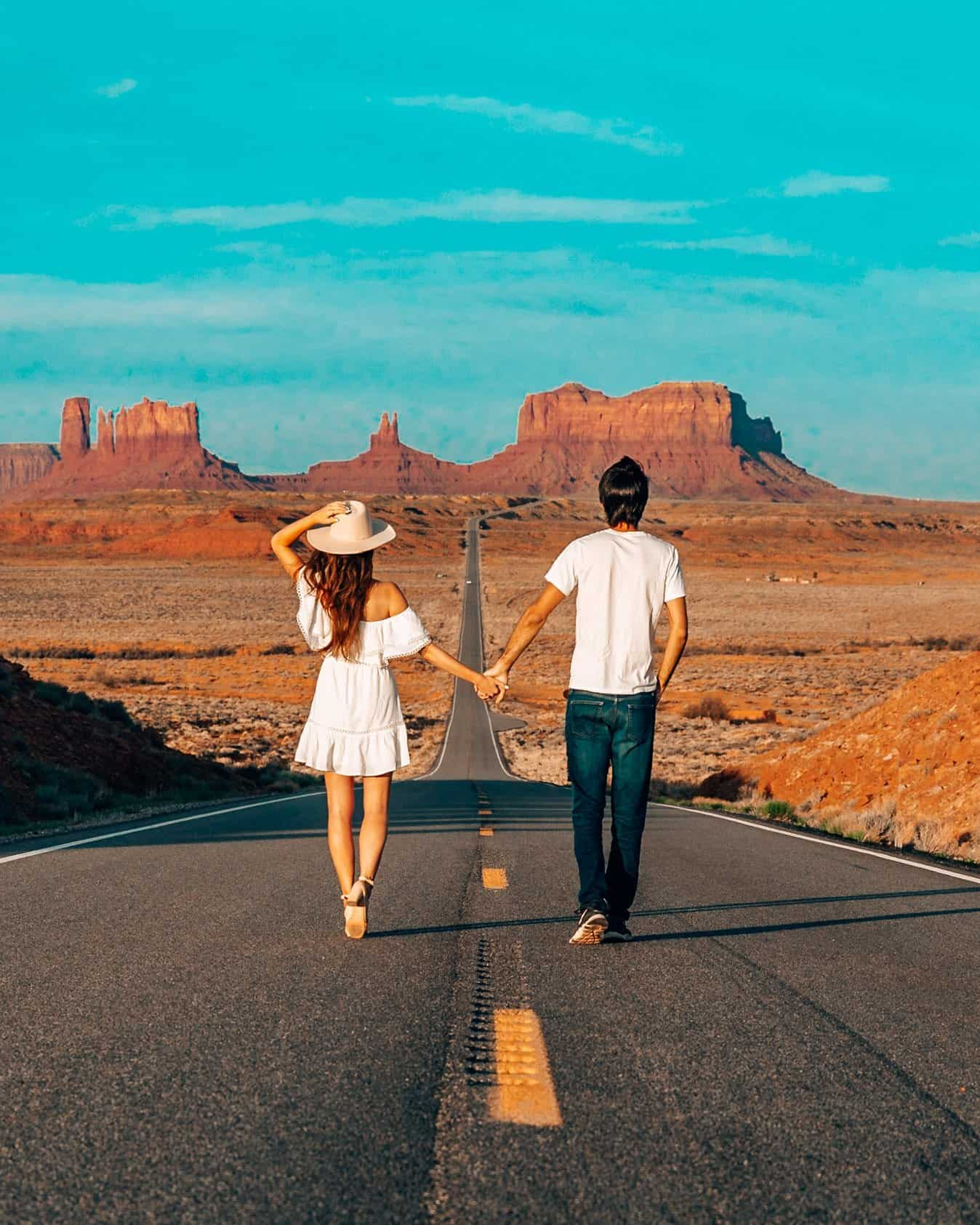 Couple Walking Towards Monument Valley at Forest Gump Hill Utah