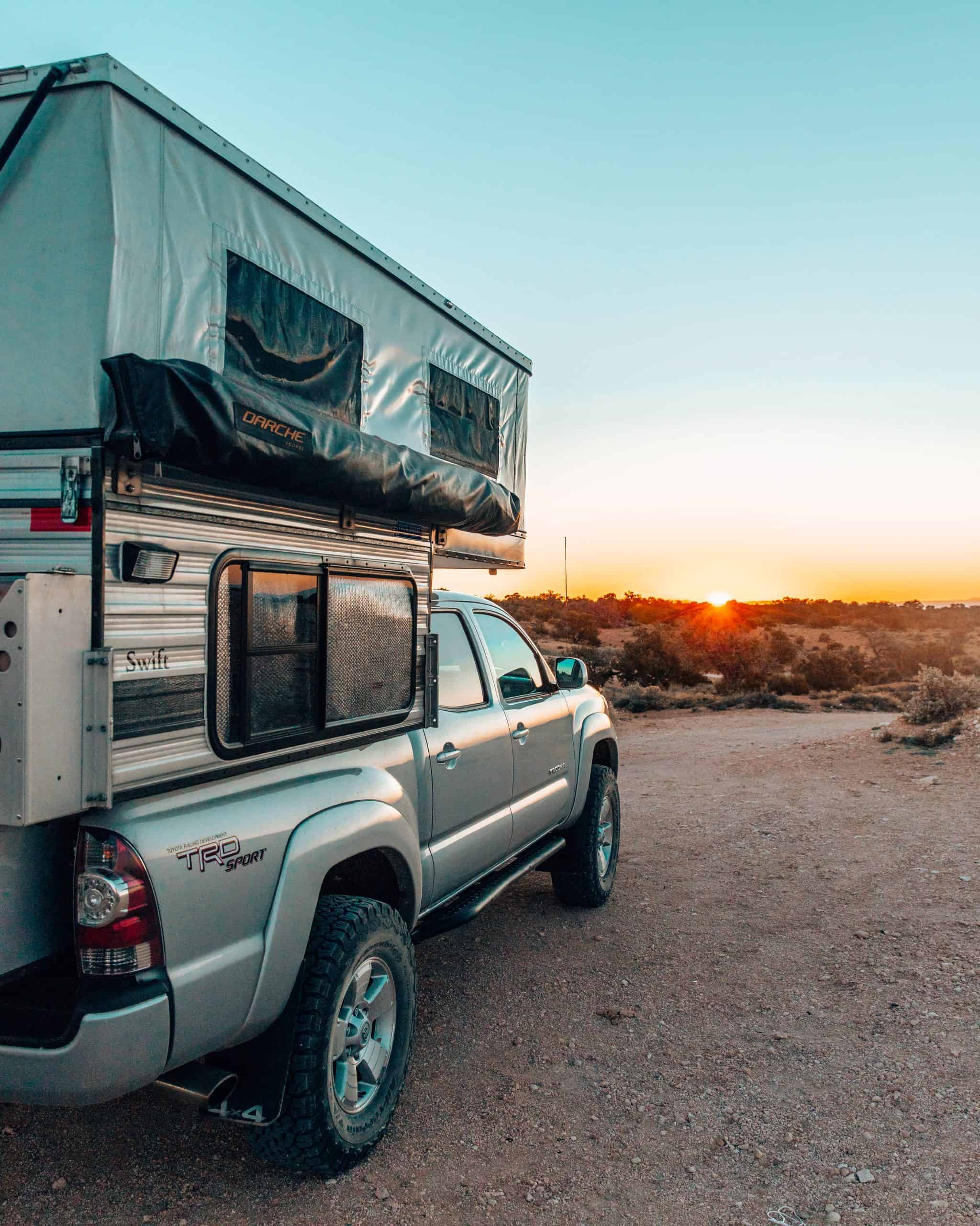 Toyota Tacoma and Four Wheel Camper Swift Model at Sunset