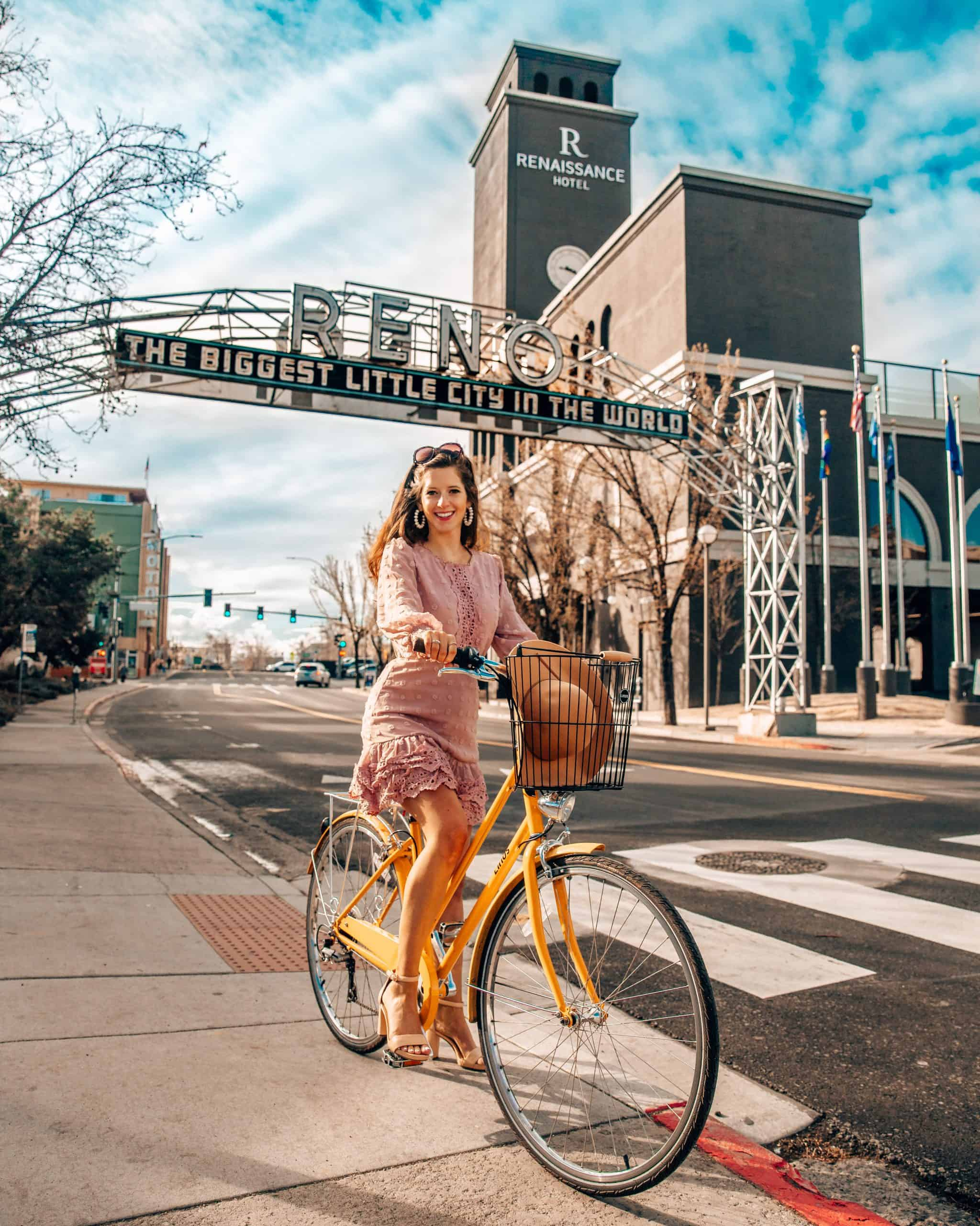 Bettina Biking under the Biggest Little City in the World Sign in Reno