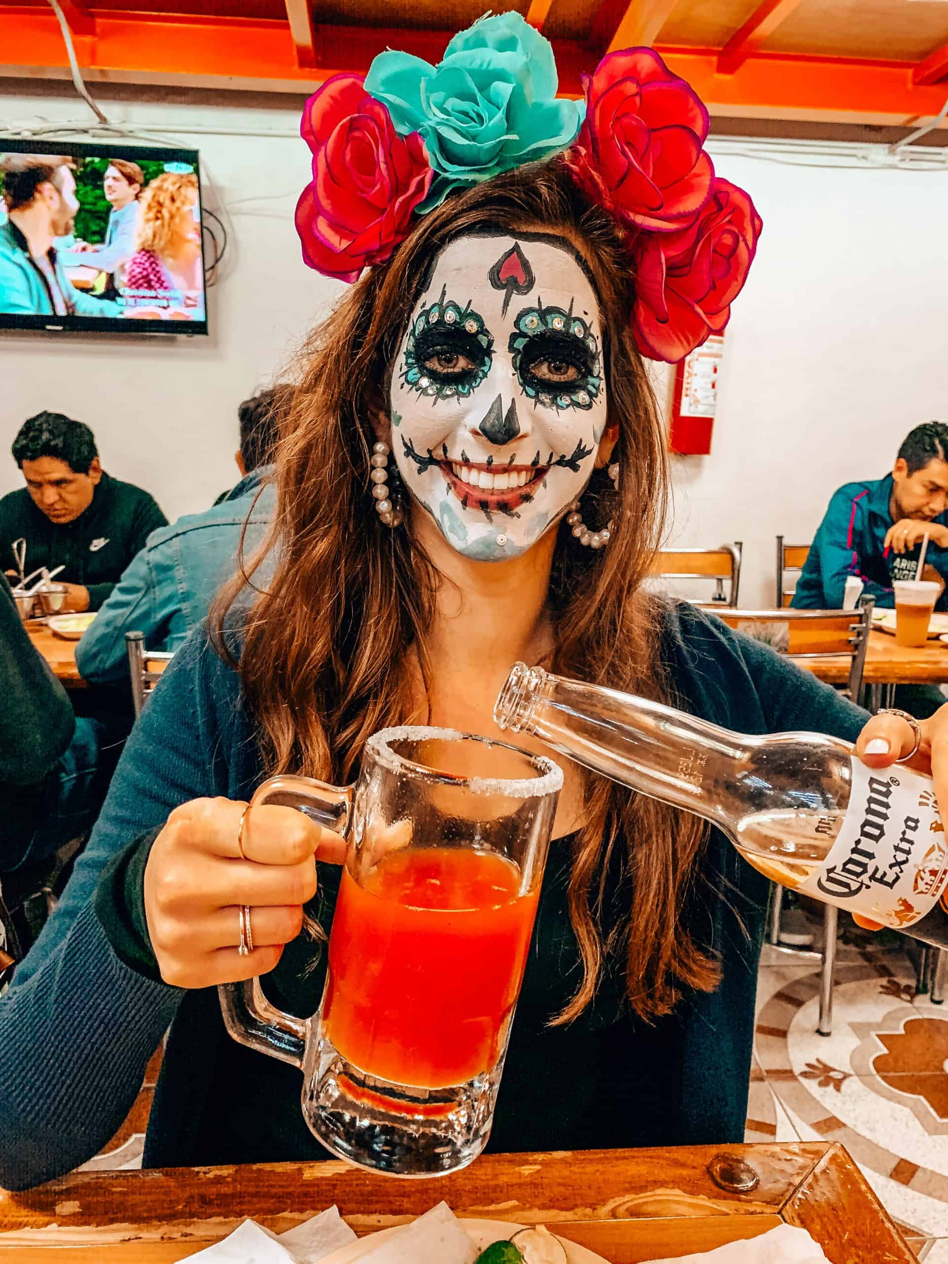 Bettina pouring a Michelada in taqueria in Mexico City