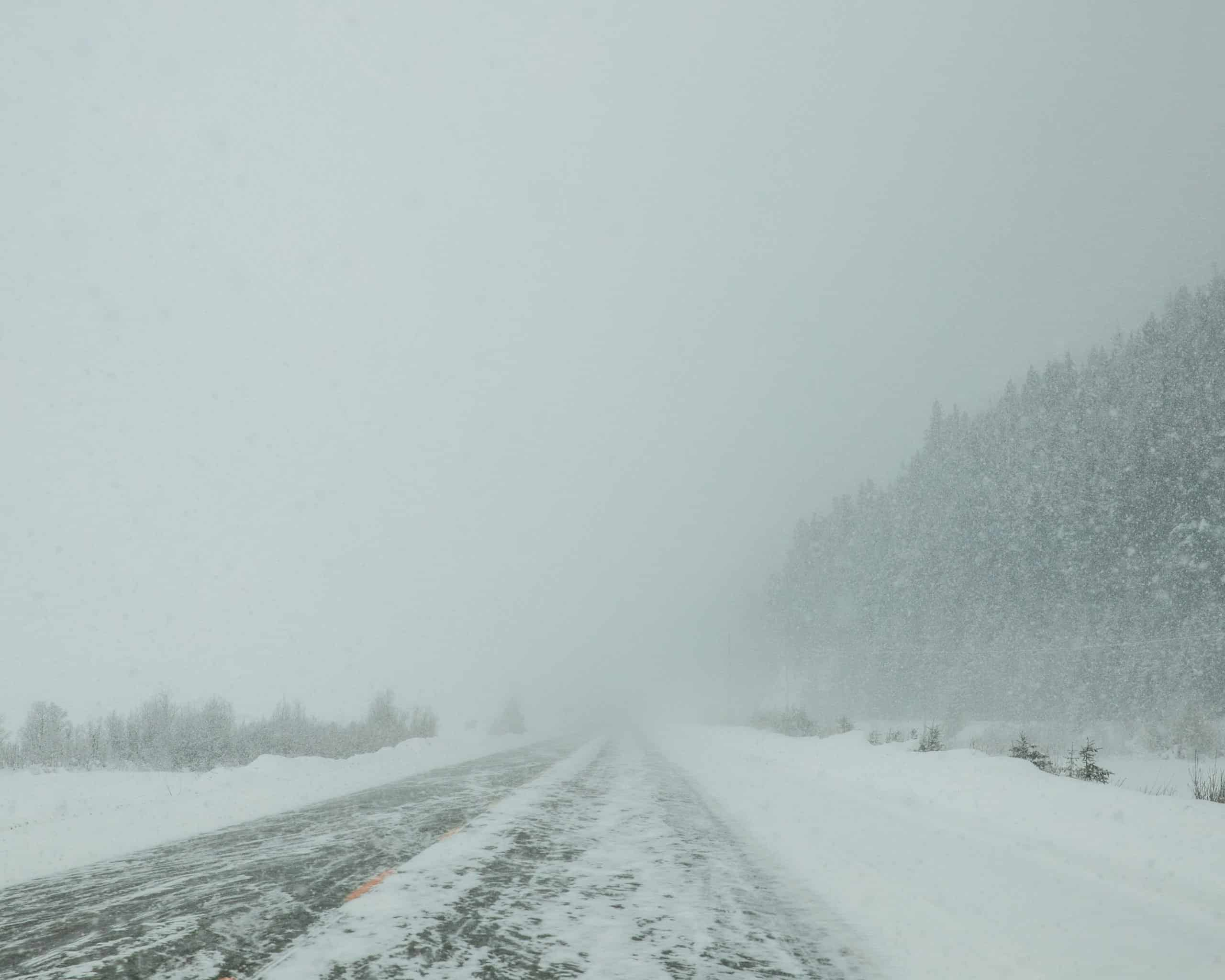 Snowstorm and snow-covered icefields parkway in Jasper, Canada