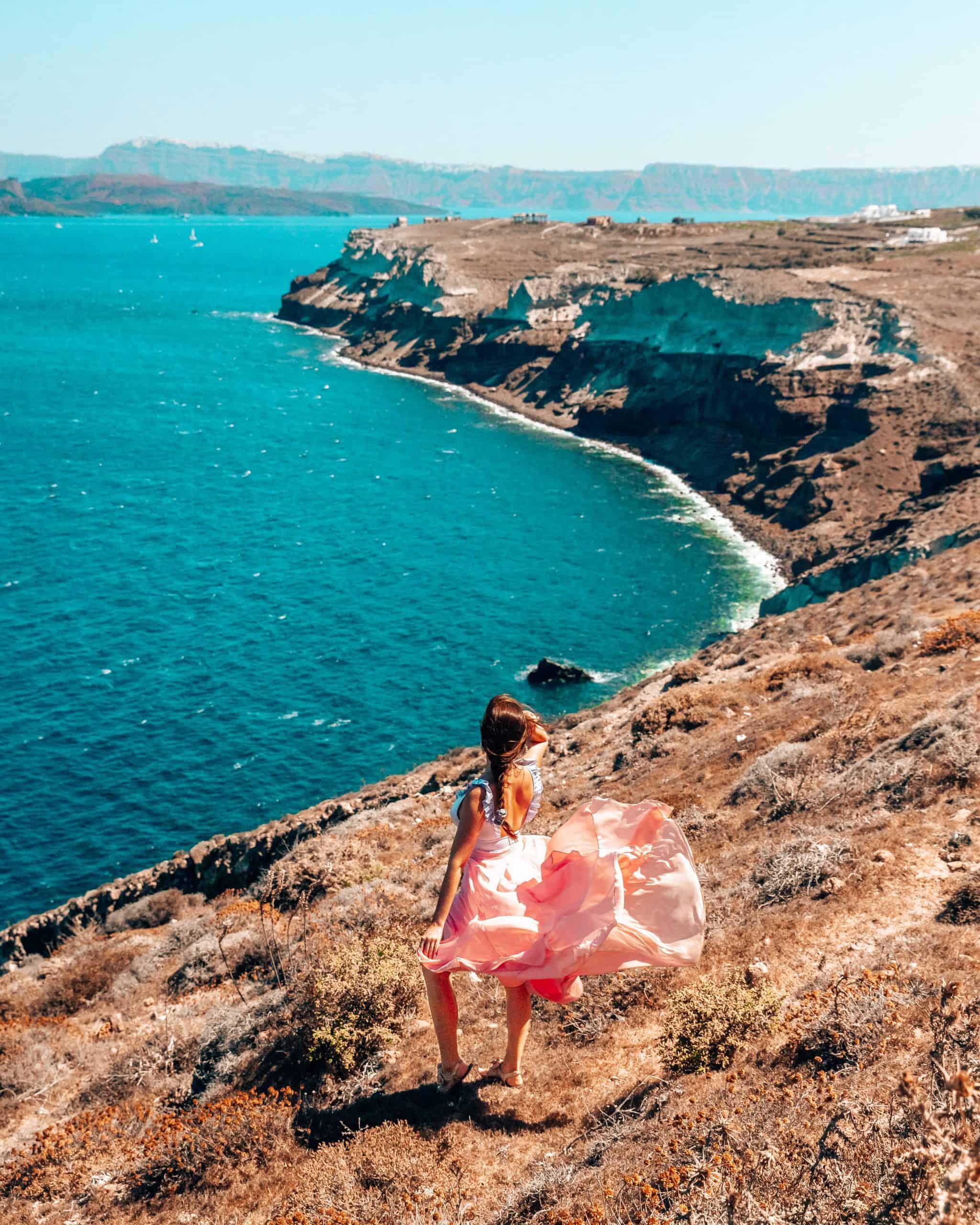 Bettina Looking at Cliffs at Santorini Lighthouse