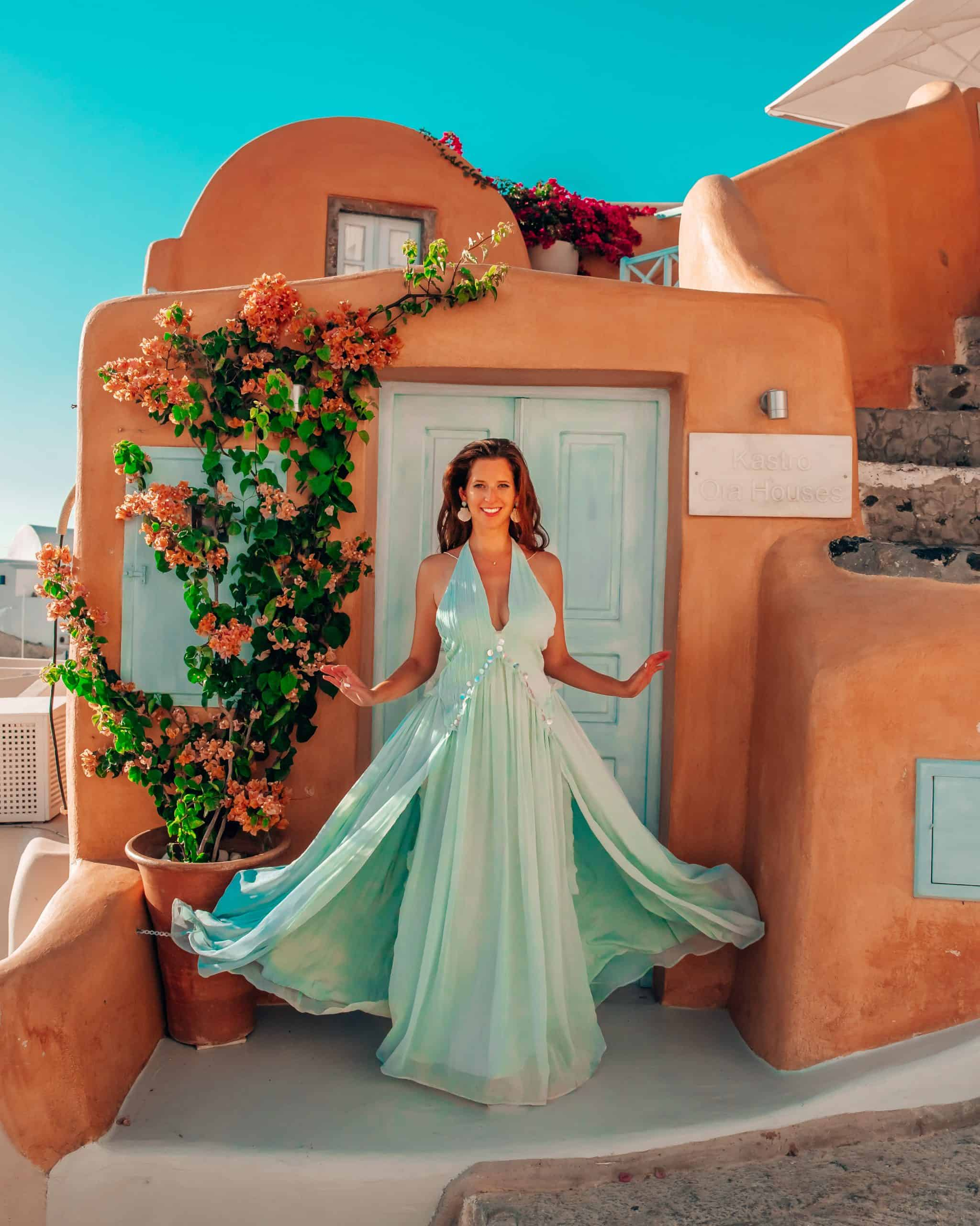 Bettina in front of Turquoise Home at Pink Kastro Homes in Oia, Santorini