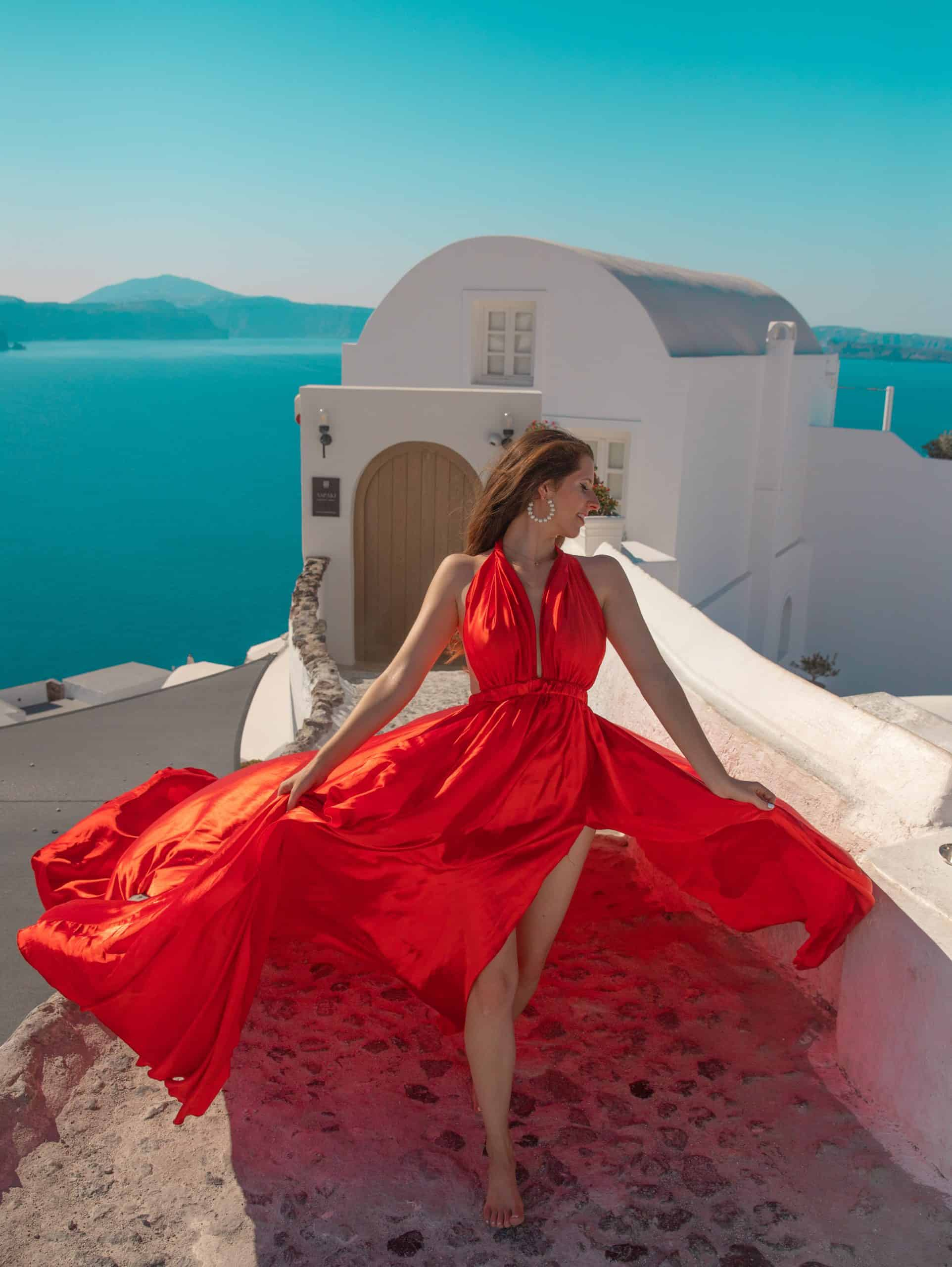 Bettina in Red Dress at typical Santorini House in Oia, Santorini