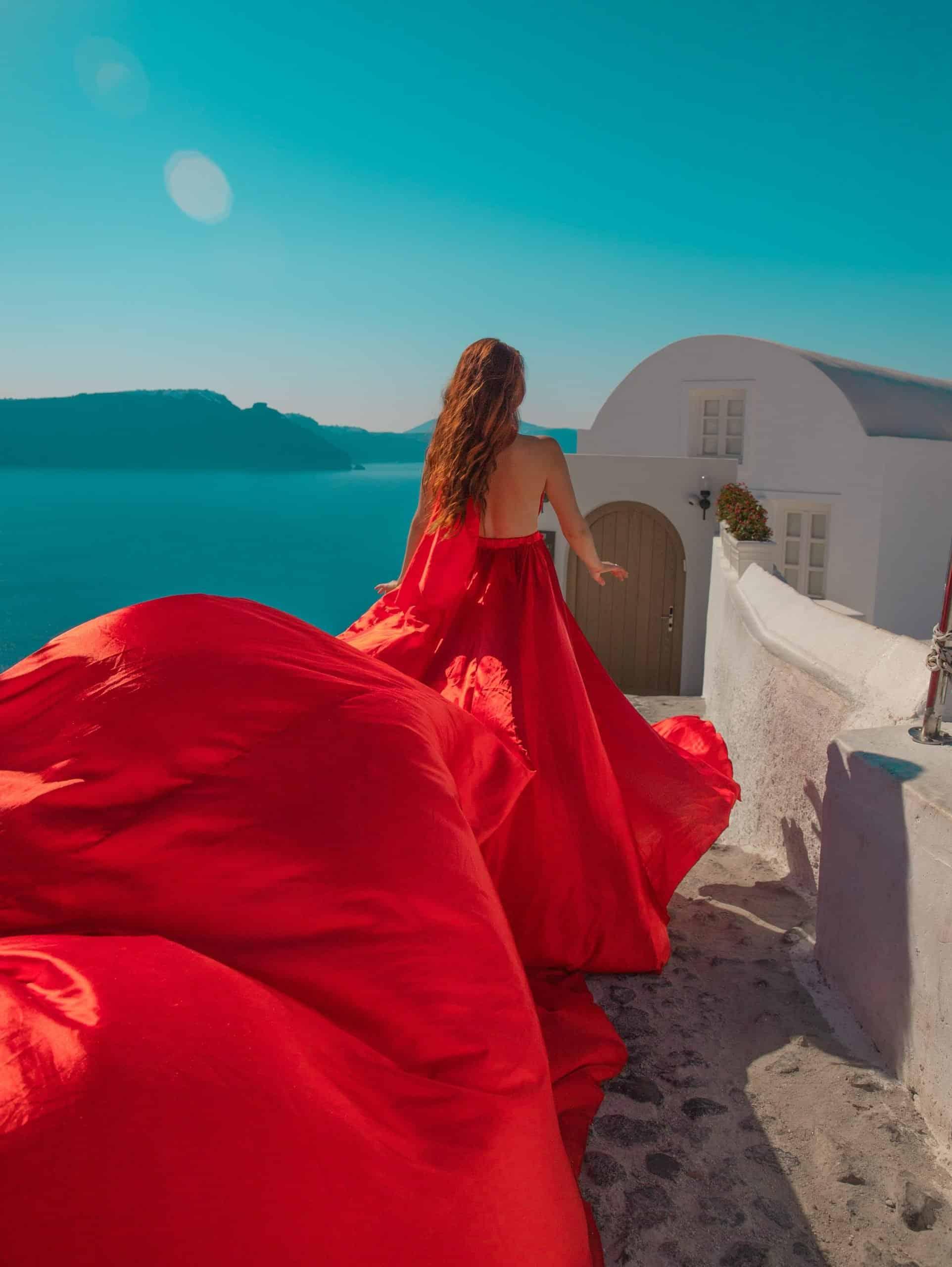 Bettina in Red Dress at Santorini House in Oia, Santorini