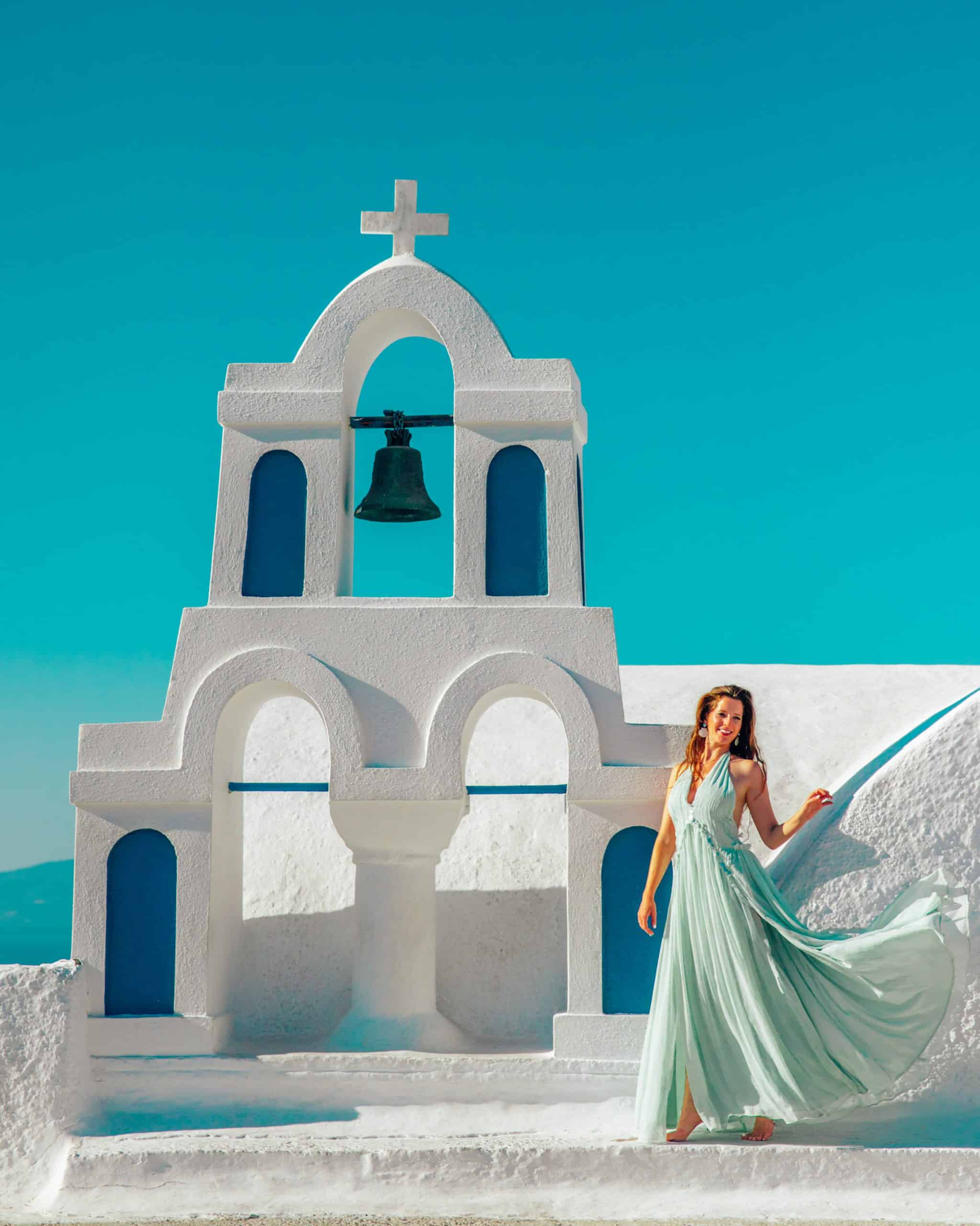 Bettina twirling at Blue Church with Bells in Oia Santorini