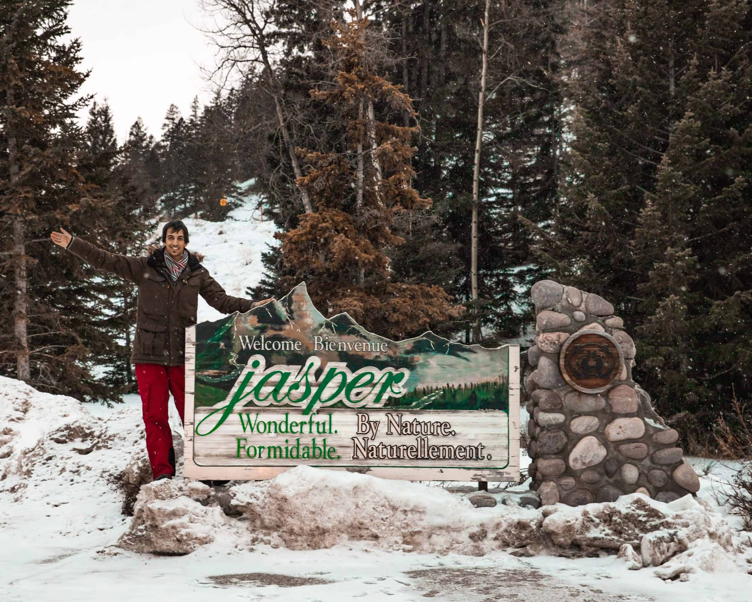 Kyle at Welcome to Jasper Sign in Winter