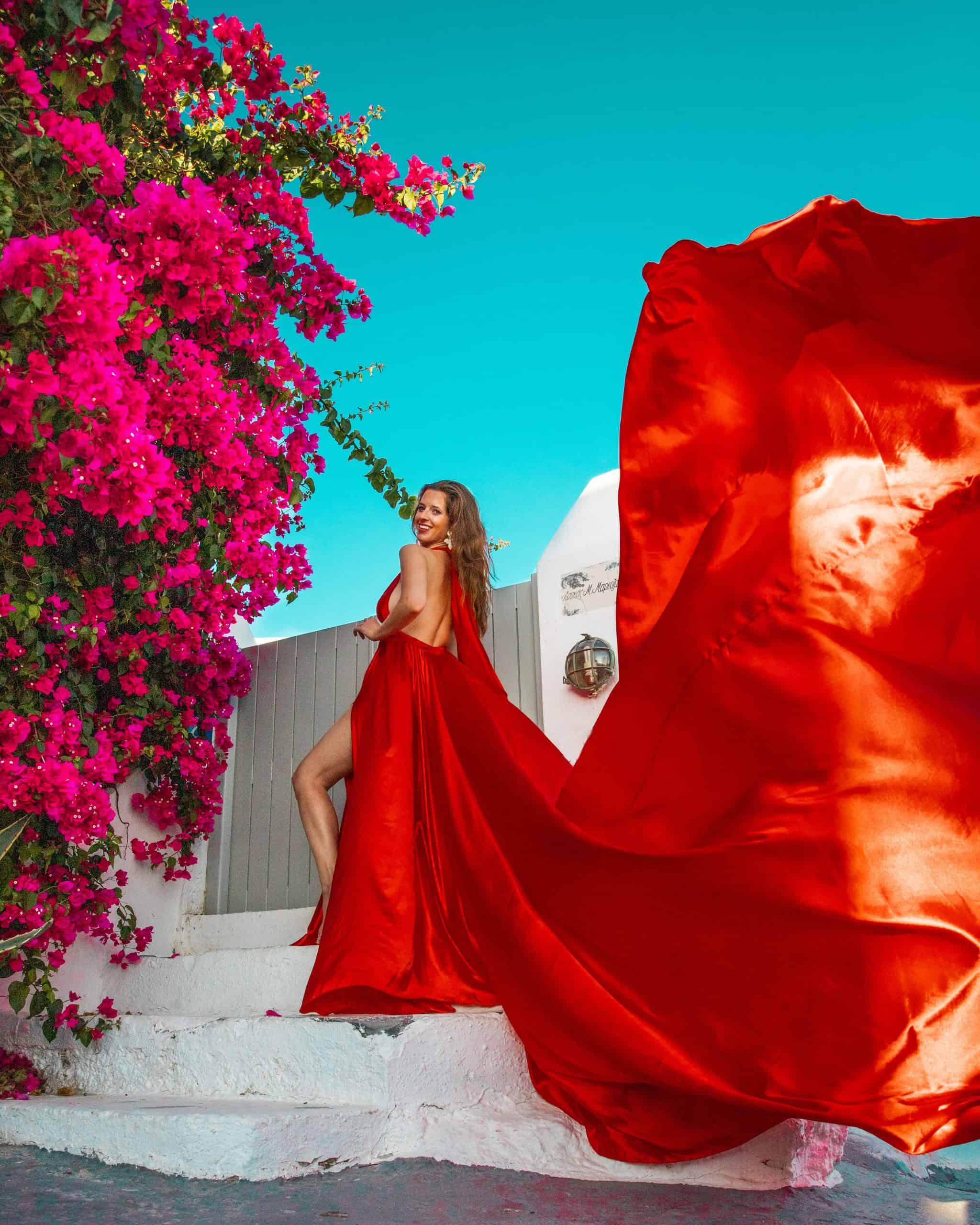 Bettina in Red Dress at Pink Tree (Bougainvillea Tree) in Imerovigli, Santorini