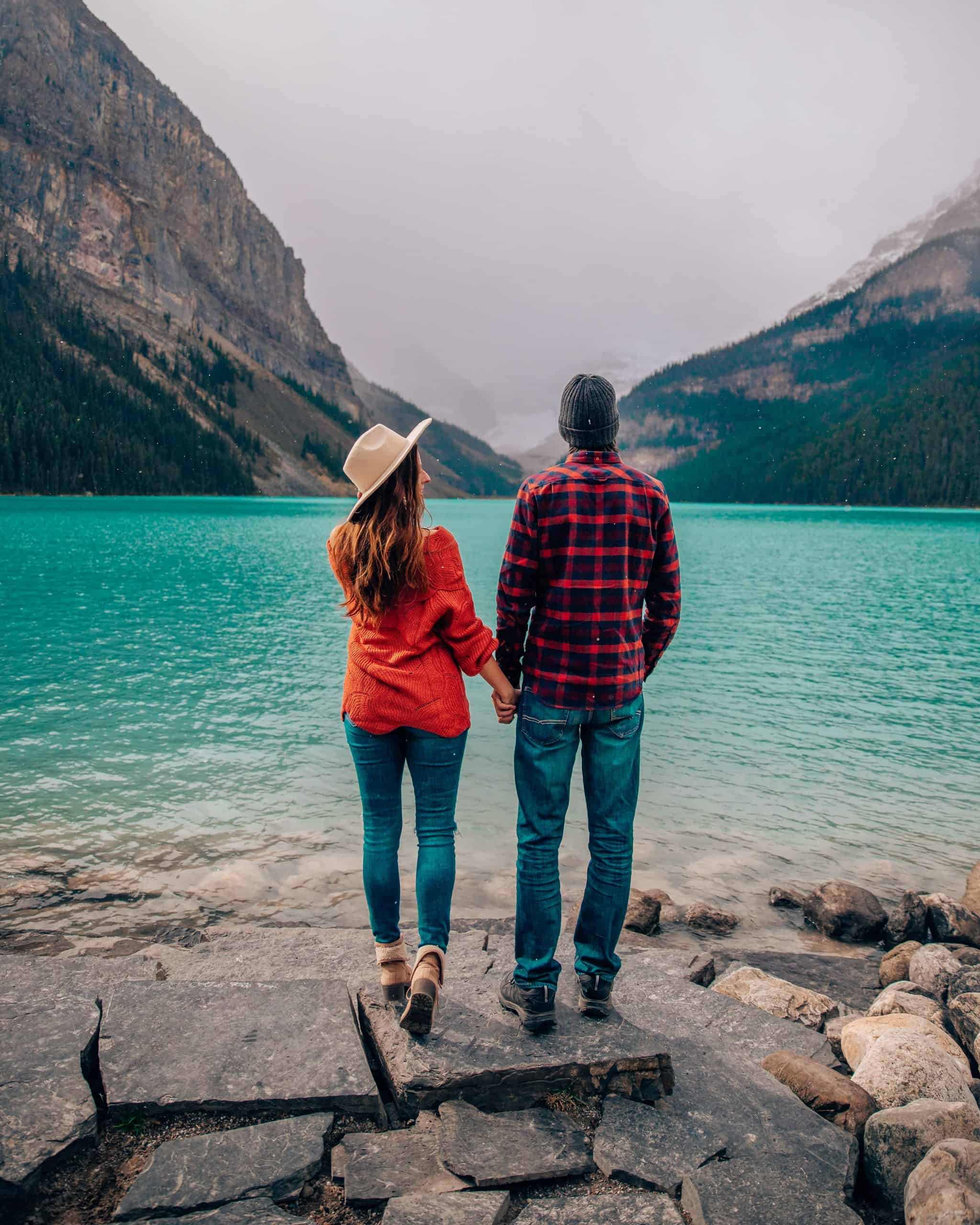 Couple Standing on the Shore of Lake Louise