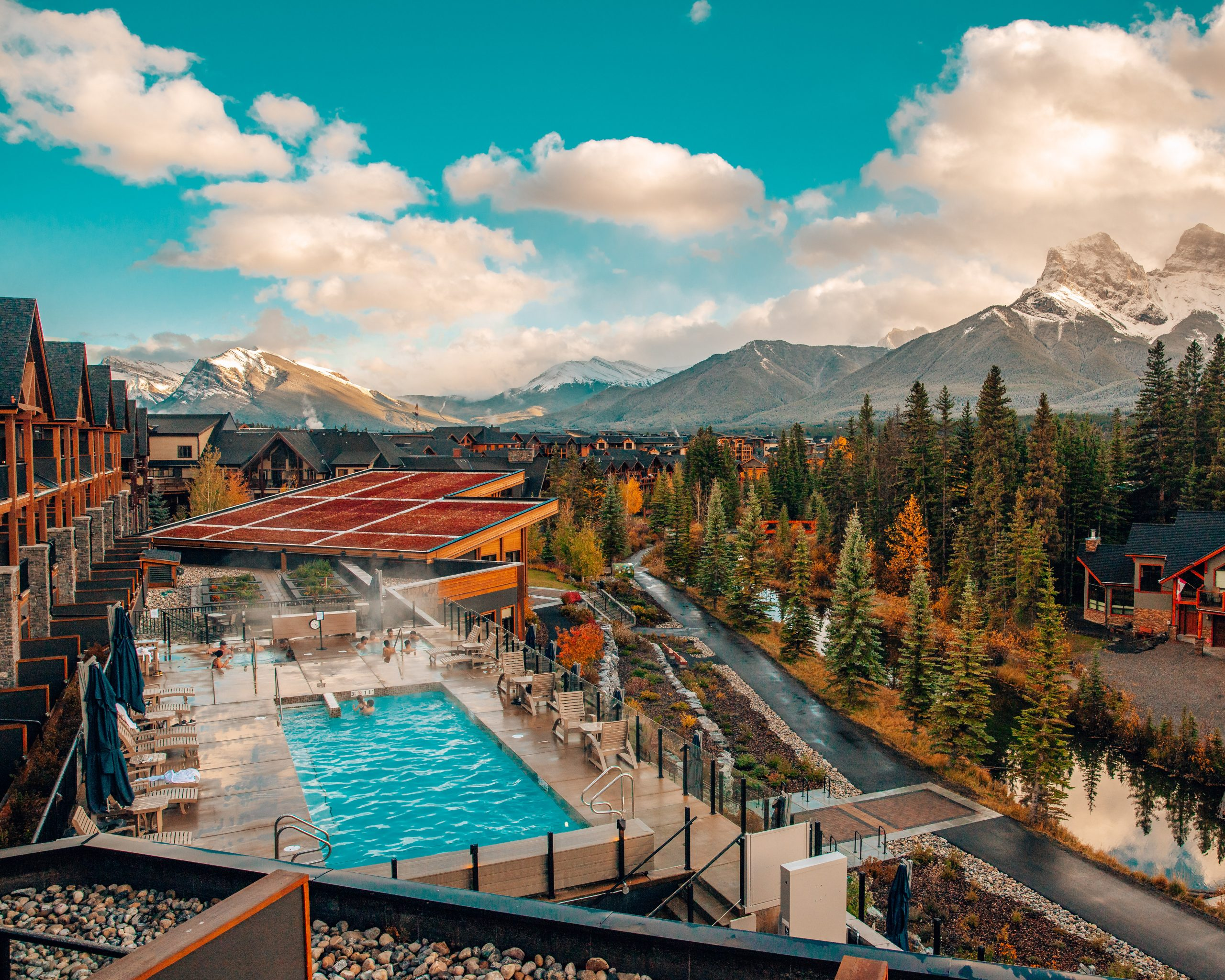 View of Outdoor Pool and Three Sisters at Malcolm Hotel Canmore