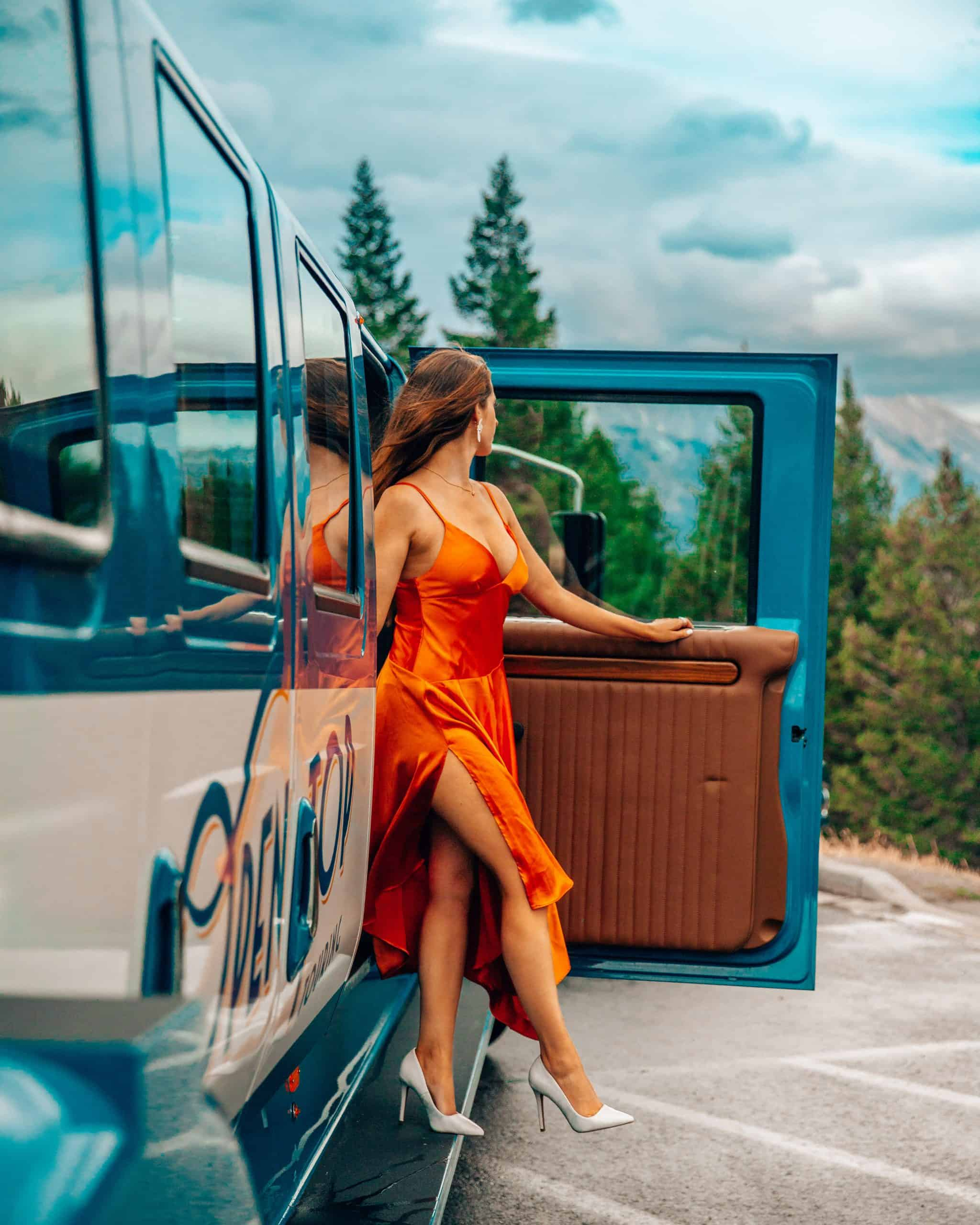 Bettina with Open Top Touring Vintage Bus in Banff