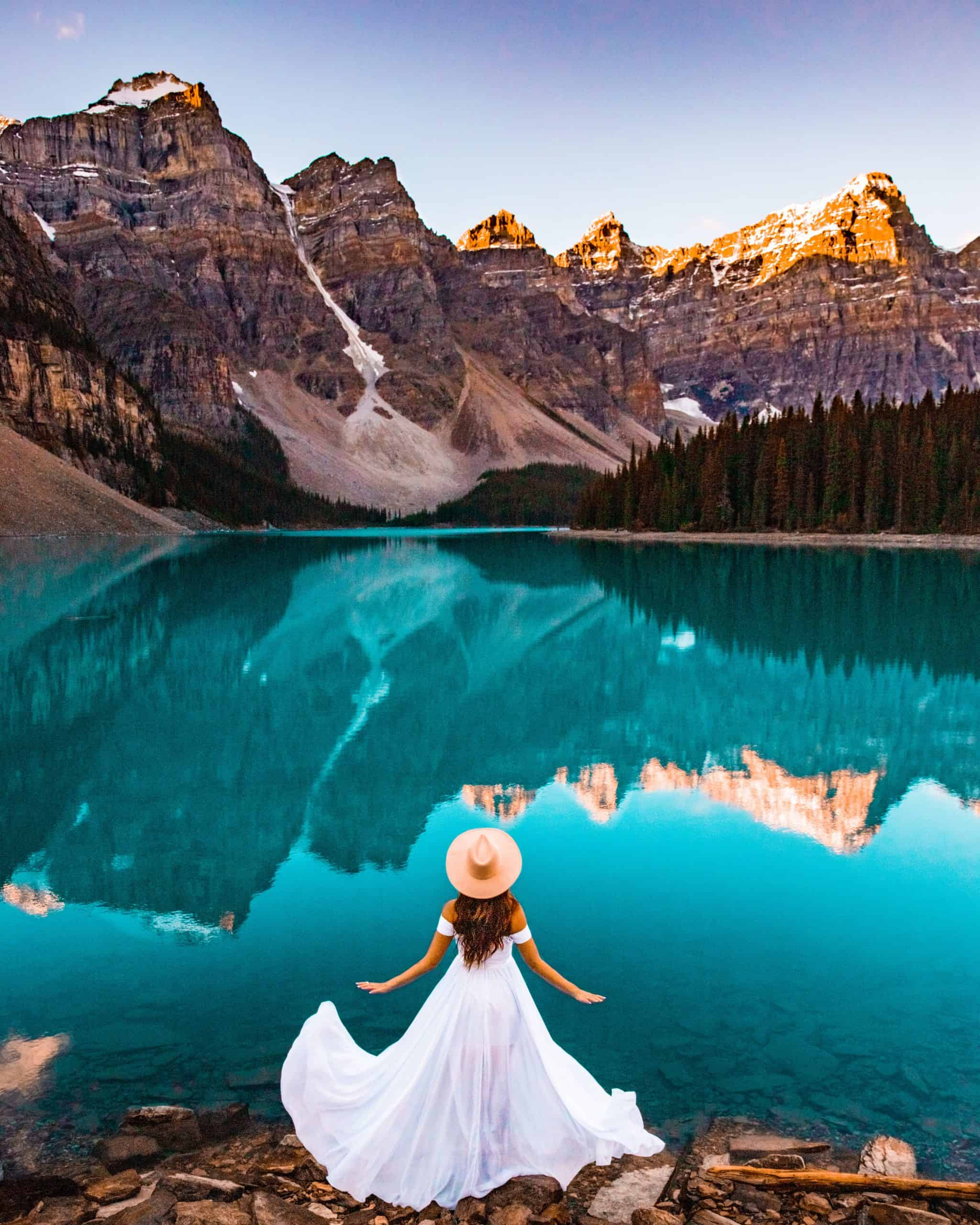 Bettina in White Dress Watching Sunrise at Moraine Lake