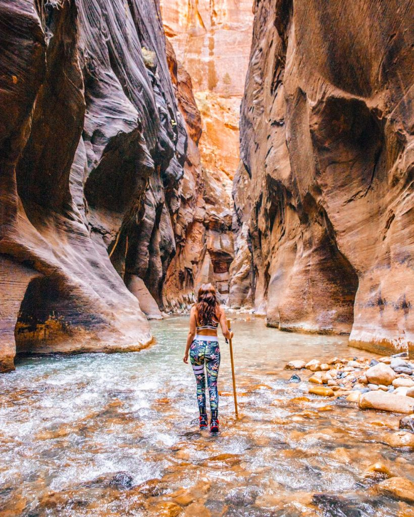 Travelwithtalia hiking the Narrows in Zion National Park Utah