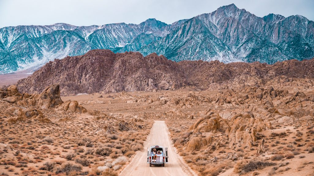 Cabana Van on the road in front of towering Alabama Hills in California