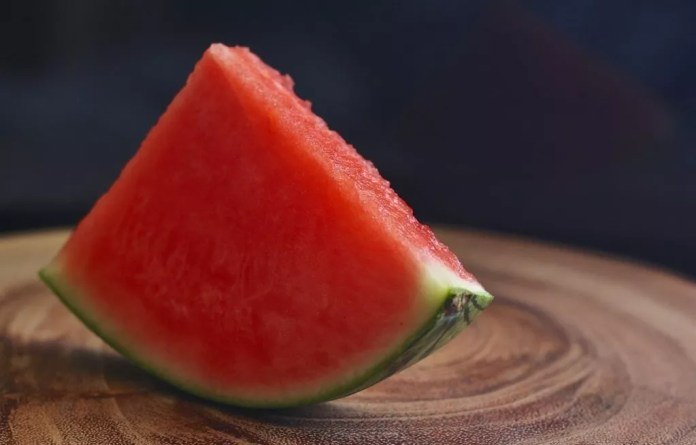 A slice of watermelon on table
