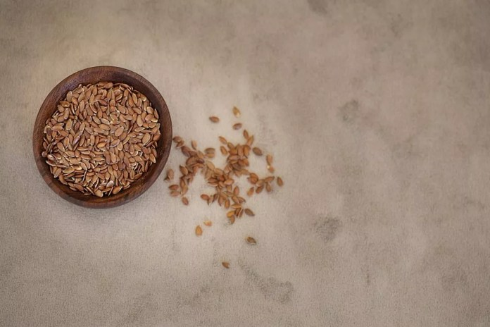 A small bowl full of flaxseeds