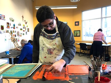 Tim Crnkovic working on a relief print