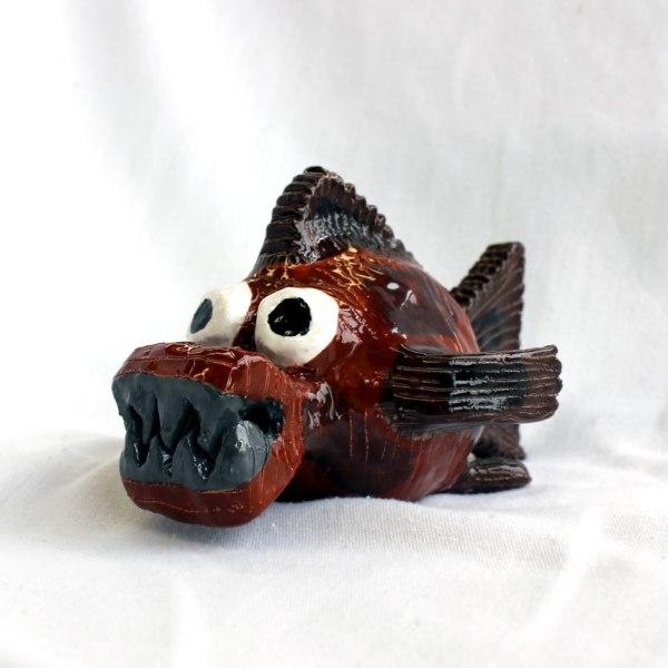 Brown and grey piranha sculpture by Amber Tyreman