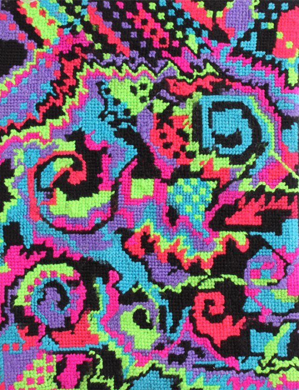 Brightly coloured abstract needlework in pink, purple, blue, green, and black
