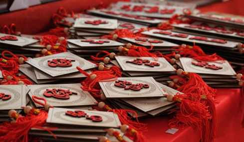 white and red lucky charm on red table