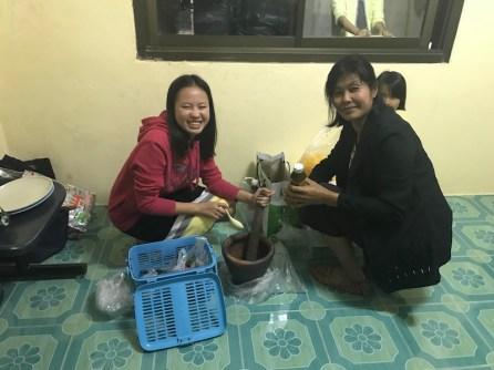 making papaya salad on the kingdom hall floor