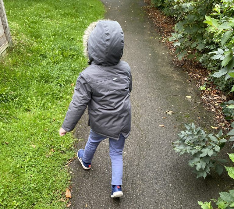 Alfie walking to the shop with excitement