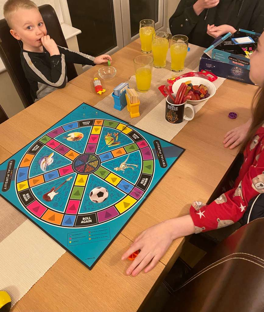 Family Playing trivial Pursuit