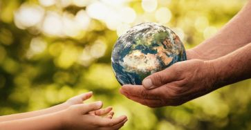 hands giving child the world