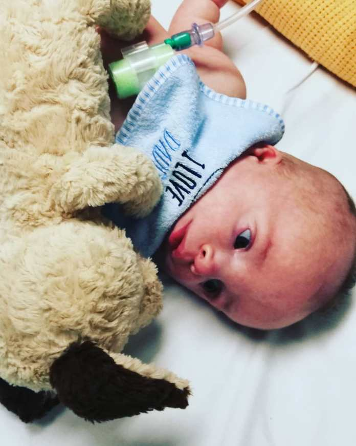 Baby Jack Laying With Teddy