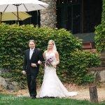 Bride and groom on lawn by veranda