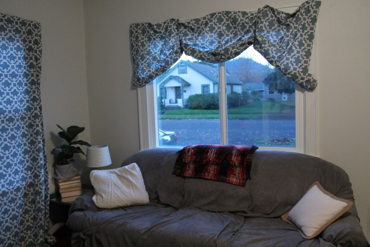 Ribbons tacked to the frame make these temporary curtains workable.