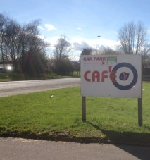 cafe 67 sign from the road