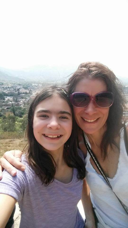 smiling mom and tween daughter