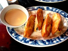 pretzel pork and chive dumplings with spicy mustard at Talde