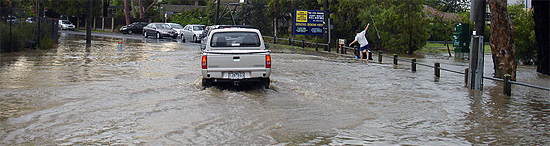 car on flooded road