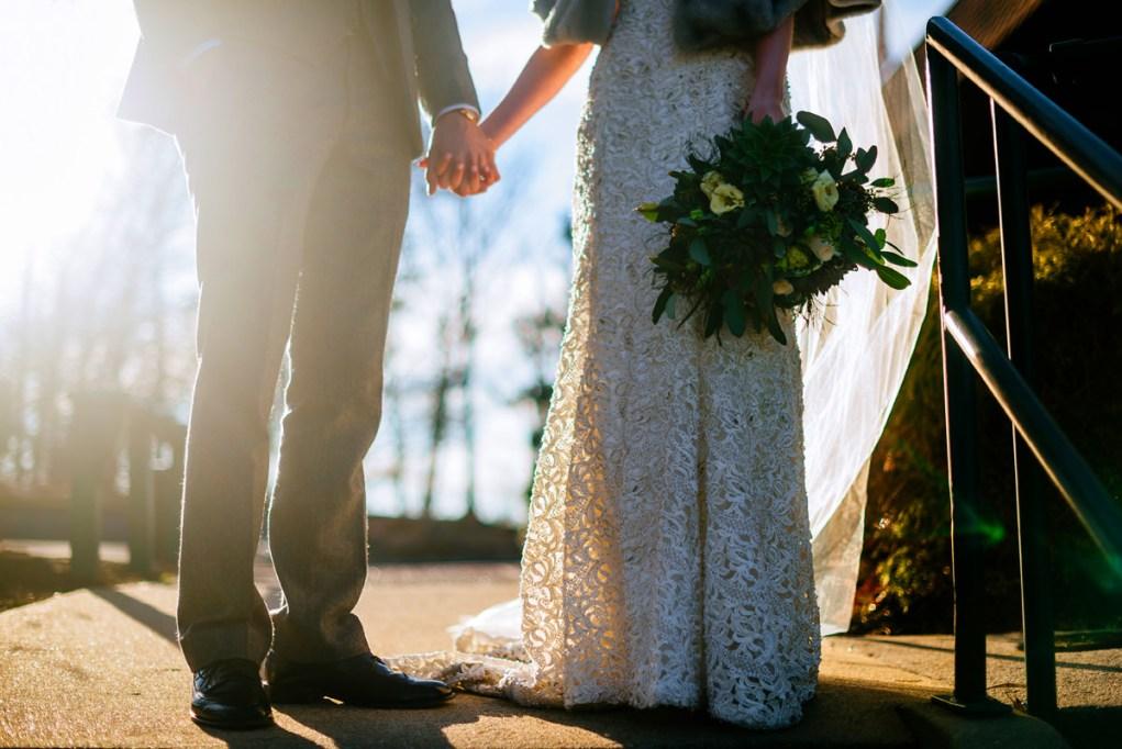 wv winter wedding holding hands