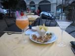 Apperitivo in Citta Alta, olives, mini pizzettes and potato chips