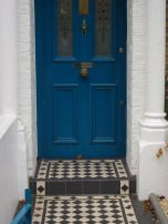 Blue door and checked tiles in Aresenal