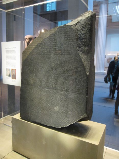 The Rosetta Stone, with Greek, Demotic and Egyptian heiroglyphics.