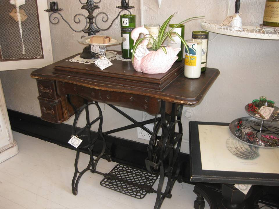 A classic sewing machine table - charming as is or ready to be refinished/repurposed