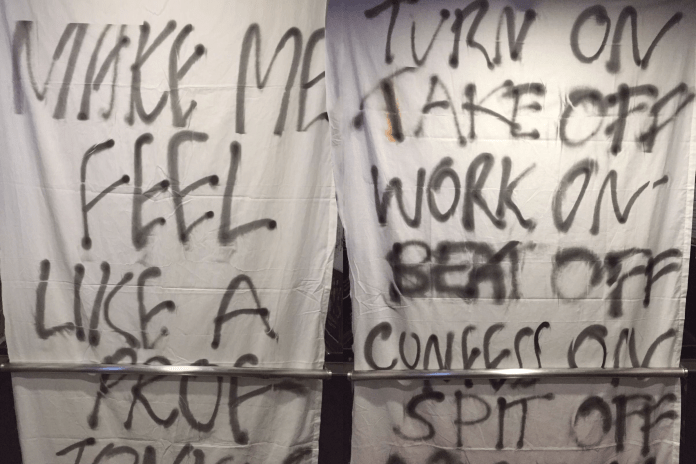"""On March 16, white sheets with spray-painted messages were draped at the back of selected lifts. In calculated museum fashion, accompanying labels announced """"This is an Art Installation"""" and provided the names of the makers, the title of the work, and the materials used. Later that day, the sheets were removed, and the makers published a post in the Yale-NUS College Students Facebook group requesting the work to be returned for its supposed sale."""
