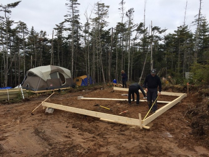 Squaring the foundation for the off grid cabin