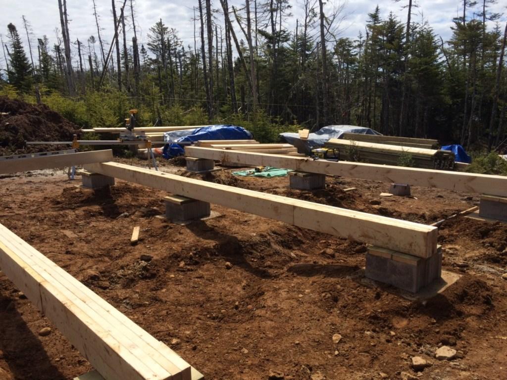 Placing the Off Grid Cabin Floor beams